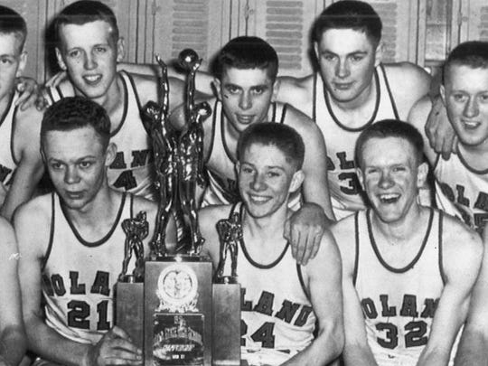 Gary Thompson, center right holding the trophy, celebrates with teammates after finishing second in the 1951 state tournament. Roland lost to Davenport in the championship game.