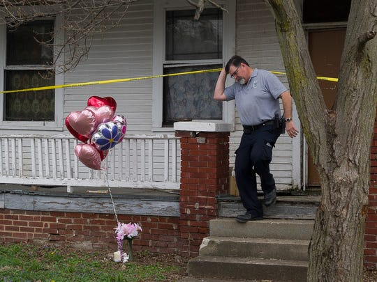 Evansville crime scene investigator Phil Luecke exits 1628 South Bedford Avenue, where the body of Aleah Beckerle was found, Wednesday, March 29, 2017.