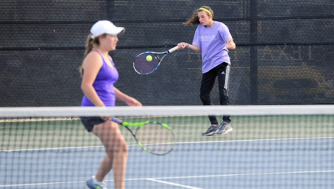 Wylie's Madison Andrews hits a shot behind girls doubles partner Hailey Parker during the Region I-4A final at Texas Tech's McLeod Tennis Center on Thursday, April 19, 2018. Andrews and Parker won the championship 3-6, 6-4, 7-5.