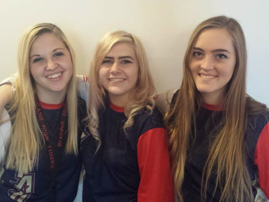 Hurricane's Brenda Christensen (left), Mackenzie Jessop (center) and Jennica Gubler (right) represented Utah  earlier this year in a national wrestling meet in Fargo, North Dakota.