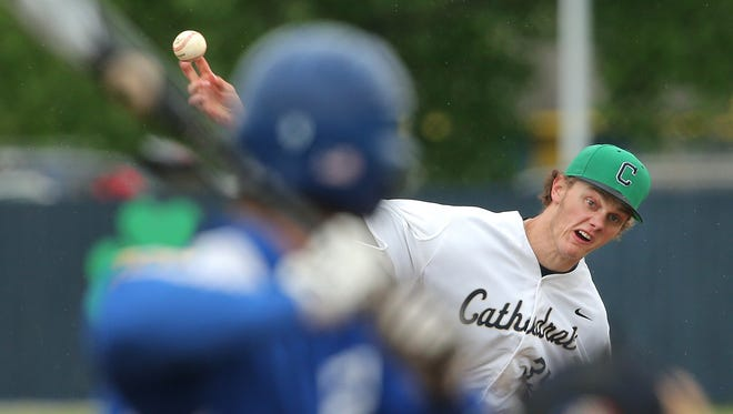 Cathedral's Ashe Russell fires a pitch to a Bishop Chatard batter, May 21, 2015. Russell is considered a potential first-round pick in the MLB draft in June.