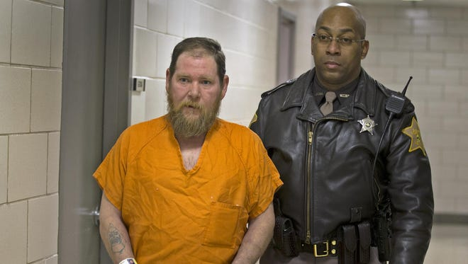 Gary Thompson is escorted to his initial hearing in the City-County Building on Jan. 30, 2015.