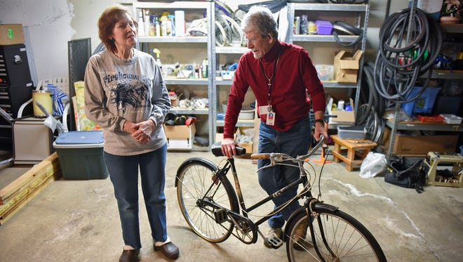 Lucy Thomas and Jon-Scott Johnson talk about their work in refurbishing and repairing used bicycles in their workspace Monday, Feb. 27, in St. Cloud.