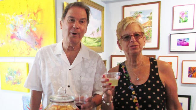 Jim and Barbara Reichley from Oviedo approved of the margarita welcome drink for First Friday's Cinco de Mayo celebration.
