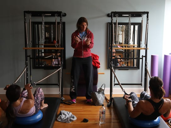 Champ teaching at the Jumping Frog Pilates studio in