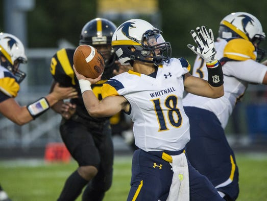 Whitnall quarterback Jacob Flores looks downfield for