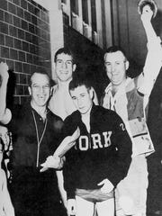 The William Penn swim team celebrates a District 3 team swimming championship. From left to right: head coach Donald Houseal, swimmer Bill Groft, swimmer Bob Ruth and assistant coach Bill Schmidt.