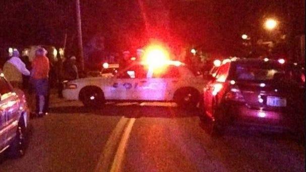 The scene on Rosemont Avenue in Sedamsville, where a Cincinnati Police officer shot an armed man Sunday, Sept. 14, 2014.