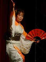 Tamiko Hayes performs for the crowd Saturday during the Japanese New Year Celebration at the Rex Theatre.