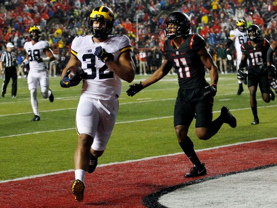 Michigan running back Ty Isaac scores a touchdown against