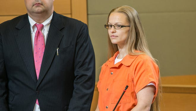 Angelika Graswald, right, stands in court as her attorneys ask for bail and to unseal the indictment against her during a hearing Wednesday, May 13, 2015, in Goshen, N.Y.