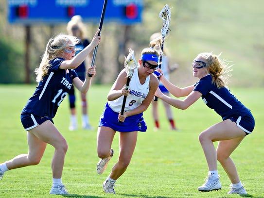 Kennard-Dale's Megan Halczuk, center, works to get