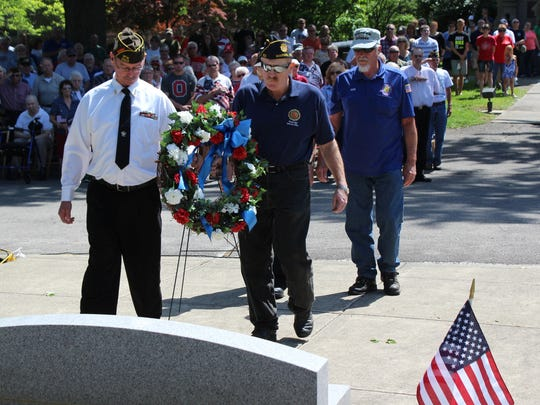 Marion County veterans place a wreath at the entrance to the World War II Veterans Memorial in Marion Cemetery. Veterans Lonnie Cox, Alvin Somerlot, Dennis Tobin and Forest Winfield participated in the wreath ceremony.