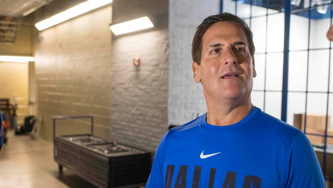 FILE -- Dallas Mavericks owner Mark Cuban is interviewed during the Mavericks media day at the American Airlines Center.