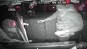 A surveillance camera provided a look at the burglars who broke into the business in Port St. John.