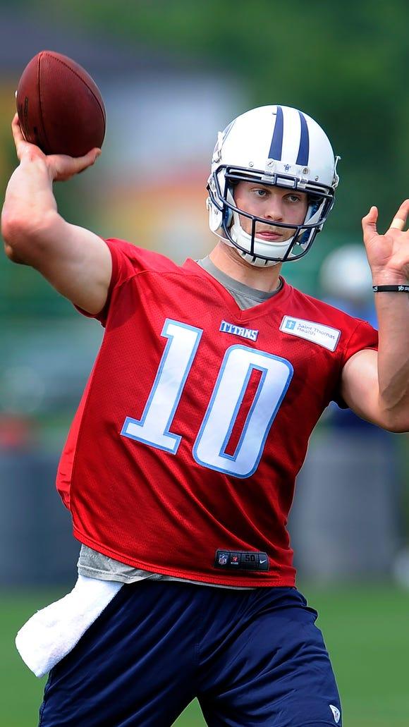 Titans quarterback Jake Locker (10) throws a pass during practice at St. Thomas Sports Park Tuesday May 27, 2014, in Nashville, Tenn.