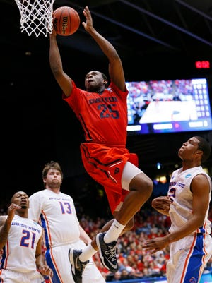 Dayton Flyers forward Kendall Pollard (25) goes up for a shot ahead of Boise State Broncos guard Derrick Marks (2) during the first half in the first round of the 2015 NCAA Tournament at UD Arena.