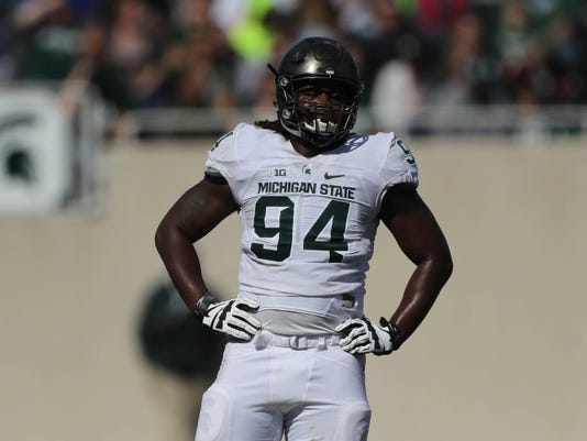 Michigan State defensive end Auston Robertson stands on the field during the Spring Game at Spartan Stadium, Saturday, April 1, 2017 in East Lansing, Mich. The former defensive end has been jailed in Indiana on a third-degree criminal sexual conduct charge filed in Michigan. (Kirthmon F. Dozier/Detroit Free Press via AP)