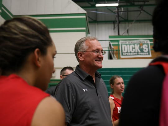 North team coach Tom Adair, who is also Bloomfield's head girls basketball coach, congratulates his players after they won Friday's 5A/6A All Star game, 67-65, over the South.