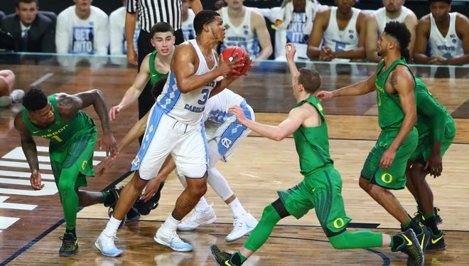 Kennedy Meeks (3) grabs an offensive rebound off a missed free throw that might have saved North Carolina's season.