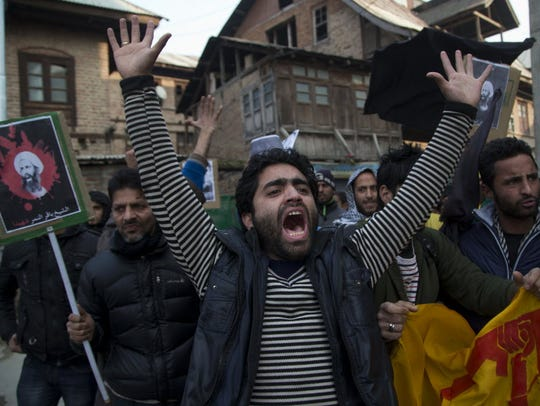 A Kashmiri Shiite Muslim man shouts slogans against
