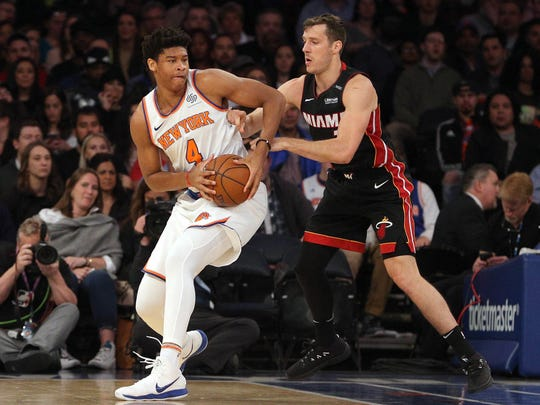 New York Knicks power forward Isaiah Hicks (4) controls the ball against Miami Heat point guard Goran Dragic (7) during the first quarter at Madison Square Garden.