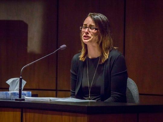 Kasey Hilpipre of Des Moines reads a victim impact