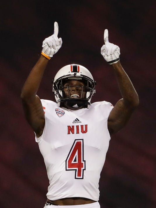 Northern Illinois wide receiver Christian Blake reacts after scoring a touchdown during the first half of an NCAA college football game against San Diego State, Saturday, Sept. 30, 2017, in San Diego. (AP Photo/Gregory Bull)