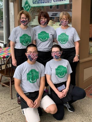 The Harvey's Bakery team shows off their shirts in Dover. In front are William Speltz and Anne O'Donnell. In back are Susan O'Donnell, Karen Speltz and Pam Simpson.