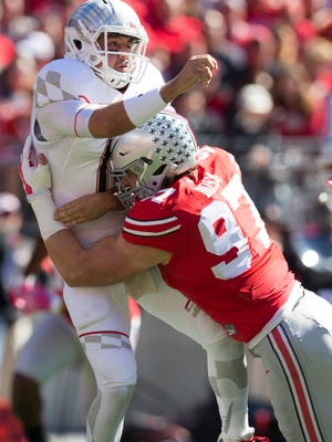Maryland quarterback Perry Hills (11) is hit by Ohio State defensive lineman Joey Bosa (97) on Oct. 10, 2015.