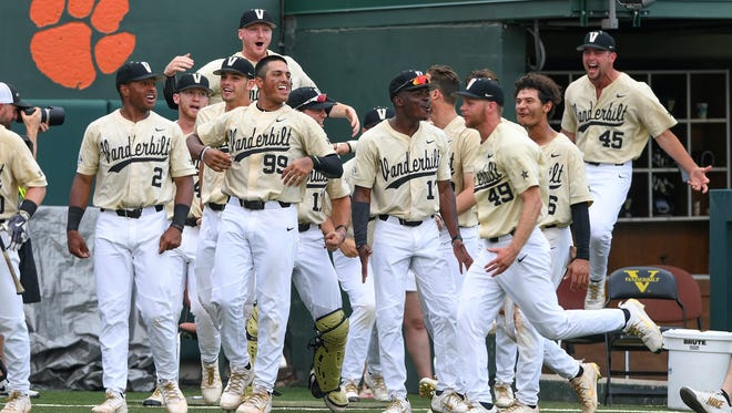 Vanderbilt's bench reacts after Philip Clarke hit a solo home run against Clemson on Sunday.