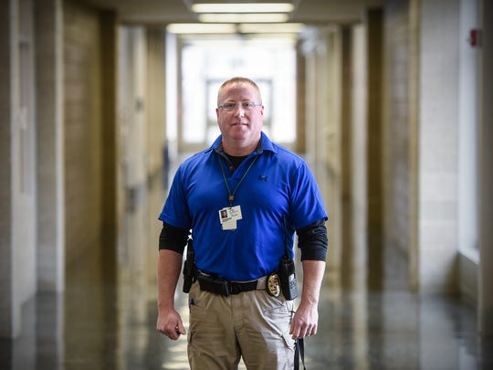 Sauk Rapids police officer Tim Sigler stands in a hallway Tuesday, Jan. 24, at Sauk Rapids High School. Sigler works as a school resource officer for schools in Sauk Rapids.