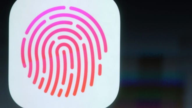 Apple Sen VP Phil Schiller pitches fingerprint sensor on the new iPhone 5S at the Apple campus, on Sept. 10, 2013.