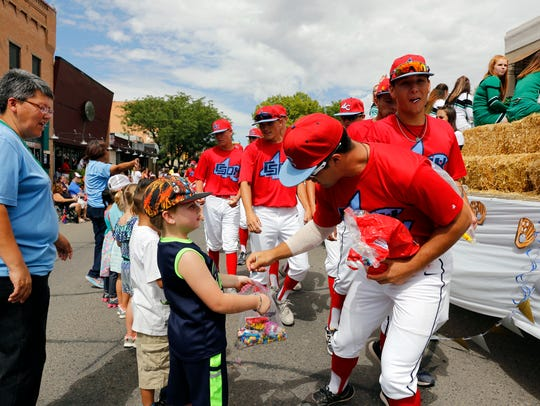 Players from the 4-C ClubSox hand out candy on Main Street during the 2017 Connie Mack World Series Parade in Farmington on July 29, 2017. The 2018 CMWS Parade starts at 10 a.m. Thursday.