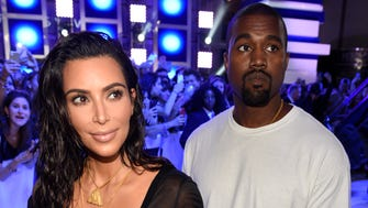 See how the stars shine upon arrival for MTV's Video Music Awards.  Kim Kardashian West and Kanye West