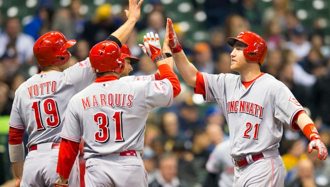 Reds third baseman Todd Frazier (21) celebrates after hitting a grand slam home run during the fourth inning Tuesday against the Milwaukee Brewers at Miller Park.