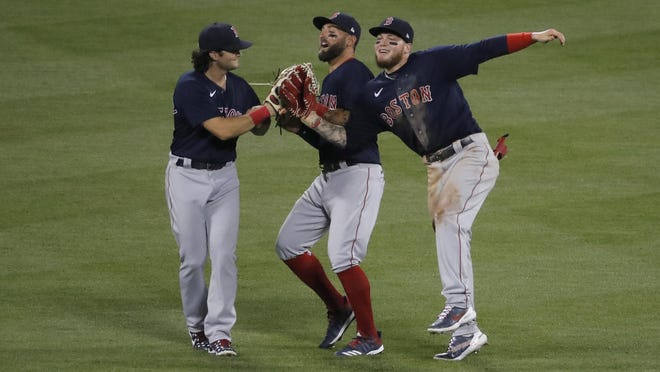Red Sox outfielders' Andrew Benintendi, left, Kevin Pillar, center and Alex Verdugo celebrate after a win over the Mets at Citi Field last week. Benintendi and Verdugo soon may be switching places in the batting order.