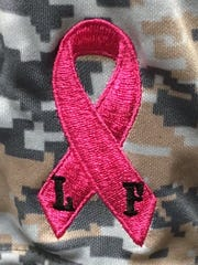 Patch worn by Arcadia baseball players to honor principal Lesley Flick.