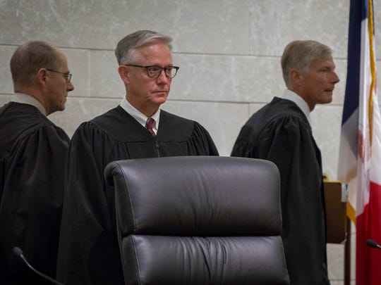 Chief Justice Mark S. Cady, center, is picturedbefore oral arguments before the Iowa Supreme Court on Thursday Oct. 20, 2016.