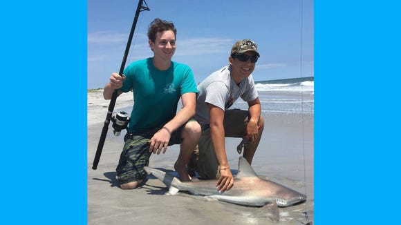 Chris Mears and Ethan Bruzzese with a brown shark landed from the Brigantine surf.