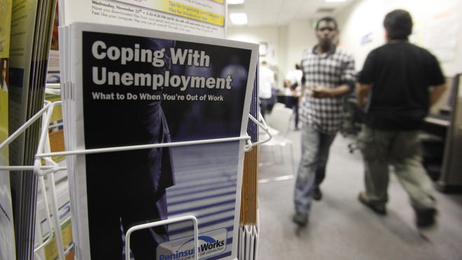 People arrive to seek employment opportunities at a JobTrain office in Menlo Park, Calif., in this file photo.  Nationally, just over 1 million Americans applied for unemployment benefits last week.