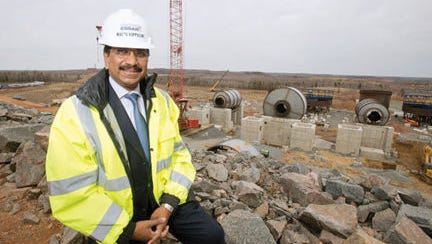 """Essar Steel Minnesota President & CEO Madhu Vuppuluri poses at the company's taconite plant construction site in Nashwauk. """"One more plant should not be the basis of whether to decide to keep another operation open or not. You should look at ways and means to keep operations going and to be creative to make operations better and to compete more effectively,"""" Vuppuluri said about Cliffs Natural Resources plans to close one of its operations if the Essar site begins production."""