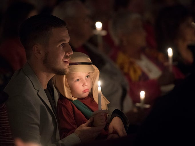 Jamie Foster and son Grayson during services at Roaring