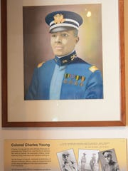 This portrait and plaque tell the story of Col. Charles