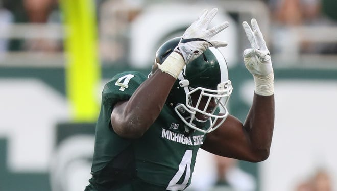 Michigan State Spartans Malik McDowell celebrates after tackling the Northwestern Wildcats Justin Jackson during second half action.
