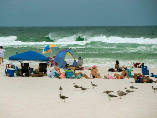 Visitors enjoy Pensacola Beach Sunday, May 27, 2018.