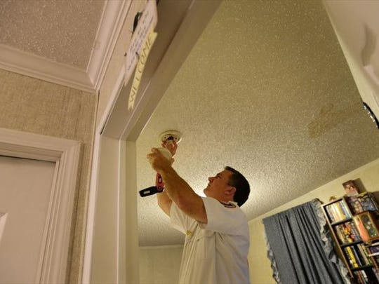 SFD Chief of Fire Prevention Jimmy Hall checks a smoke alarm in a residence. Shreveport Fire Department emphasizes the importance of keeping a working smoke and carbon monoxide detector in the home.