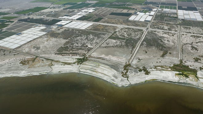 Agricultural lands sit along the fringe of the northwest shore of the Salton Sea on Tuesday, April 15, 2015. California's largest lake will begin receding more rapidly in 2018, when the flows of water to it decrease under the nation's largest agriculture-to-urban water transfer deal.