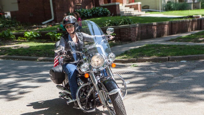 Joni Ernst rides her Harley in Red Oak in July while running for U.S. Senate.