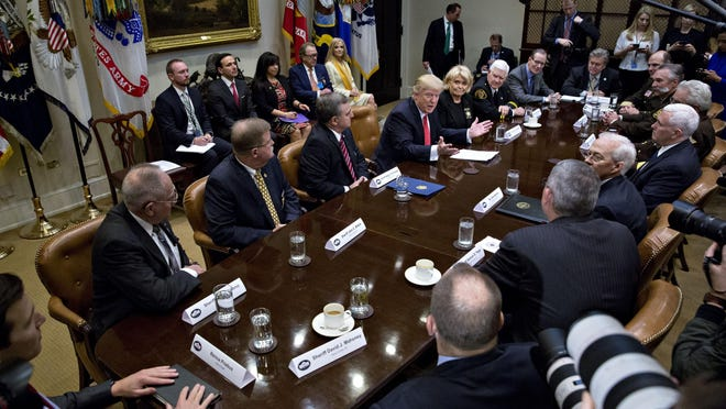 President Donald Trump speaks with county sheriffs at the White House on Feb. 7. In Collier County, some deputies have been delegated the responsibilities of immigration officers.